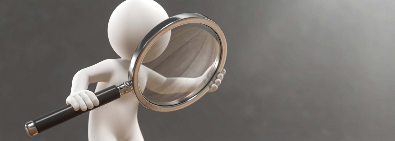 Onderzoekend poppetje met een vergrootglas